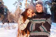 Free A Young Handsome Man Of European Appearance And A Young Asian Girl In A Park On The Nature In Winter Royalty Free Stock Images - 133772009