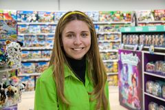 Free A Young Happy Girl 20 -25 Years Old, A Seller In A Children`s Toy Store. Favorite Work. Portrait Of A Woman, Positive Emotions. Stock Photo - 165843010