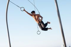 Free A Young Man Athlete Working Out On Traveling Rings On Muscle Beach, Santa Monica, California Stock Photos - 161149163
