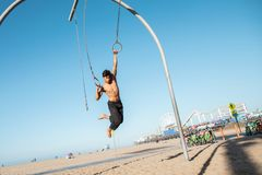 Free A Young Man Athlete Working Out On Traveling Rings On Muscle Beach, Santa Monica, California Stock Photo - 164830280