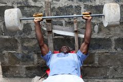 Free A Young Man Practices Weightlifting In Accra, Ghana Royalty Free Stock Photos - 115244118