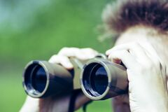 Free A Young Man With Military Binoculars In His Hands Royalty Free Stock Image - 188284916