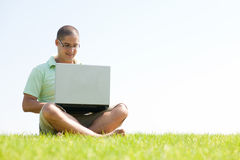 A Young Men Sit On The In The Park Using A Laptop Royalty Free Stock Photo