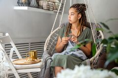 Free A Young Pretty Girl With Dreadlocks Knits At Home. Royalty Free Stock Photo - 192203735