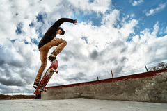 Free A Young Skateboarder Makes Wallie In A Skatepark, Jumping On A Skateboard Into The Air With A Coup Royalty Free Stock Photos - 89397888
