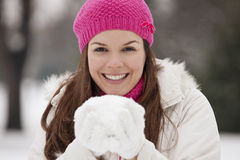 Free A Young Woman Holding A Handful Of Snow, Smiling Stock Photography - 67261352