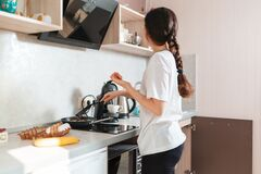 Free A Young Woman Is Frying Eggs For Breakfast On An Induction Stove. Side View. The Concept Of A Home-cooked Meal Stock Photography - 216593652