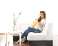 A Young Woman Sitting In A Modern Background Royalty Free Stock Images