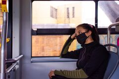 Free A Young Woman Wearing A Mask On Public Transport Stock Photography - 183014072