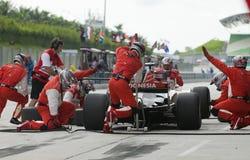 A1 de veranderende banden van Indonesië van het Team bij pitstop. stock fotografie