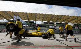 A1 Team Malaysia pit crews practice tyre change. SEPANG, MALAYSIA - NOVEMBER 22 :  A1 Team Malaysia pit crews practice tyre change at A1GP World Cup of Royalty Free Stock Image