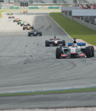 A1 Teams racing at the start of A1GP race. SEPANG, MALAYSIA - NOVEMBER 23 :  A1 Teams racing at the start of feature race at A1GP World Cup of Motorsport in Stock Photo