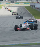 A1 Teams racing at the start of A1GP race. SEPANG, MALAYSIA - NOVEMBER 23 :  A1 Teams racing at the start of feature race at A1GP World Cup of Motorsport in Royalty Free Stock Photo