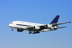 A380 Airliner in flight on clear sky Stock Images