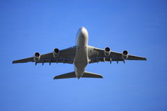 A380 flying low. A380 jet aircraft flying low overhead Royalty Free Stock Photo