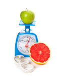 Aa apple, a grapefruit, measure tape and scale Royalty Free Stock Photos