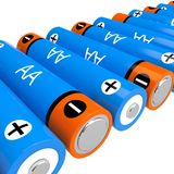 AA batteries. Row of AA batteries isolated on a white background Royalty Free Stock Photo