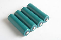 AA batteries. Four AA batteries royalty free stock image