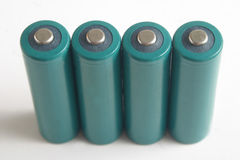 AA batteries. Four AA batteries royalty free stock photography