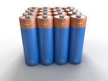 AA batteries in rows. Rows and columns of blue AA batteries on white Stock Photos
