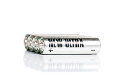 AA Battery. Silver AA battery cells on white background Royalty Free Stock Photo