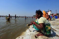 AA devotee takes bath in the river during the Kumbh Mela Royalty Free Stock Photos