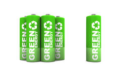 AA Double A Batteries. A group of environmentally friendly green energy double a batteries. A small group of AA batteries with a single battery standing alone Stock Photos