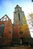The Aa-kerk or The Der Aa Church. The Der Aa Church with its striking yellow tower and medieval arches is one of the most iconic buildings in Groningen. Upon Royalty Free Stock Photo