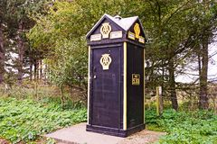 AA PHONE BOX. Traditional AA phone box used for emergency assistance with vehicle br eakdowns. With a distinctive shape, built from wood these have been the Stock Photography