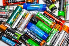 AA rechargeable batteries on the table. Miami, US - JANUARY 18, 2018: Diverse rechargeable batteries on the table Stock Images