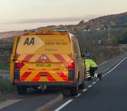 SHEFFIELD, UK - 20TH OCTOBER 2018 - AA repair van and mechanic at the side of the road royalty free stock image