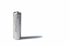 AA-size battery over white. Silver AA size battery over white. Standing Royalty Free Stock Photos