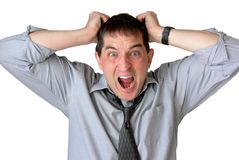 Aaaarg!. Frustrated businessman, with sleeves rolled up and tie loosened, screaming and pulling his hair stock images