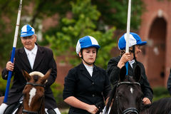 AABENRAA, DENMARK - JULY 6 - 2014: Participating riders in a par. Ade at the annual tilting festival in Aabenraa stock photo