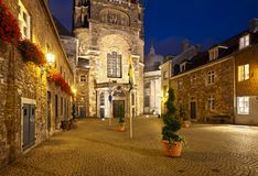 Aachen Domhof At Night, Germany. The Domhof behind the cathedral of Aachen, Germany with night blue sky Royalty Free Stock Photo