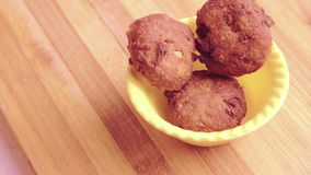 Aaloo cutlet put on bowl one by one using stop motion, indian food stock footage