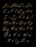 Aalphabet set of gold glittering sparklers strokes. Aalphabet set of gold glittering sparklers slashes. Font of sparkling starsdust flourish tail Royalty Free Stock Image