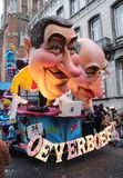 Human Caricatures, Aalst Carnival, Belgium. AALST, BELGIUM, 3 MARCH 2019: One of the brightly lit floats during the annual carnival parade in Aalst, which is a royalty free stock photo
