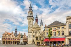 City belfry at the Grote markt of Aalst in Belgium. AALST,BELGIUM - MAY 21,2018 - City belfry at the Grote markt of Aalst. The 15th-century belfry next to the royalty free stock images