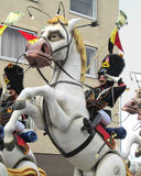 Aalst Carnival, 2014. AALST, BELGIUM, MARCH 03 2014: Unknown Aalst costumed carnival participant, rides on a float in the annual parade. The Carnival is Stock Image