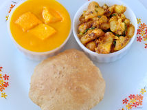 Aam Ras with Puri Sabji. Aam Ras(Mango pulp) with Puri and Potato curry royalty free stock photography