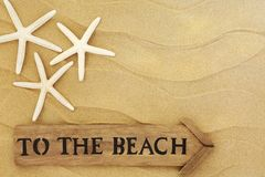 Aan het strandteken stock afbeeldingen