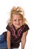 Aanbiddelijk jong meisje dat haar neus scrunching Stock Foto