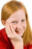 Aanbiddelijk jong meisje met haar hand op wang stock foto