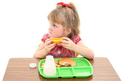 Aanbiddelijk Meisje Ongelukkig met Schoolmaaltijd stock foto