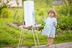 Aanbiddelijk weinig schilder Stock Foto's