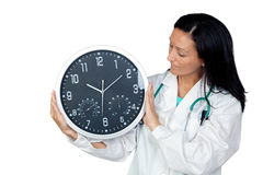 Aanbiddelijke arts met een grote klok Stock Afbeeldingen