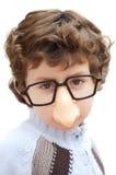 Aanbiddelijke jongen met glazen en neus van stuk speelgoed stock afbeelding
