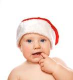 Aanbiddelijke peuter in de hoed van Kerstmis die op whit wordt geïsoleerdd royalty-vrije stock afbeelding