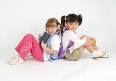 Aanbiddelijke schoolgmeisjes Stock Afbeeldingen